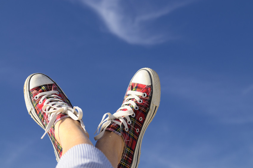 a photo of someone's shoes and the sky