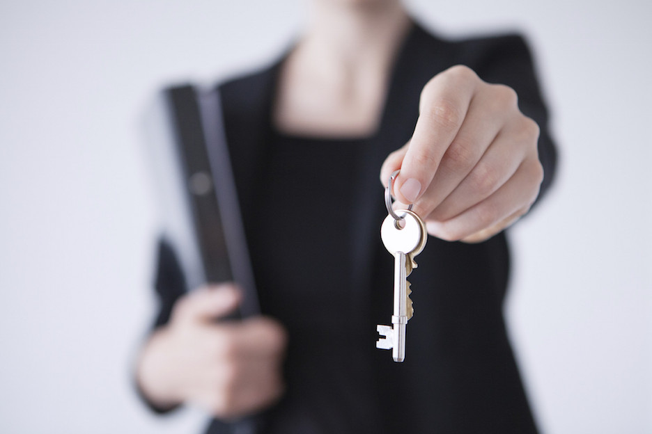 real estate agent with keys