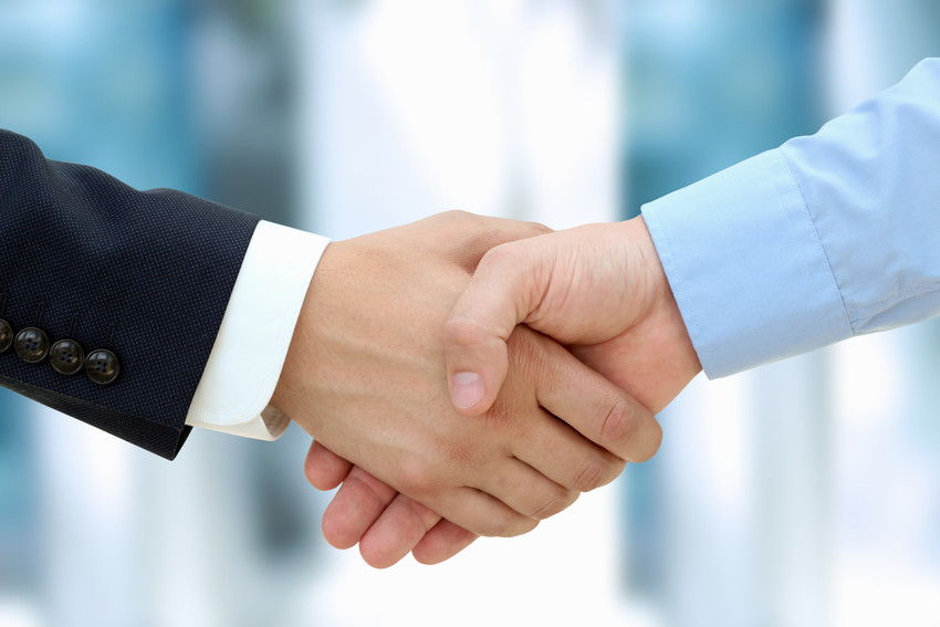 realtor and seller shaking hands