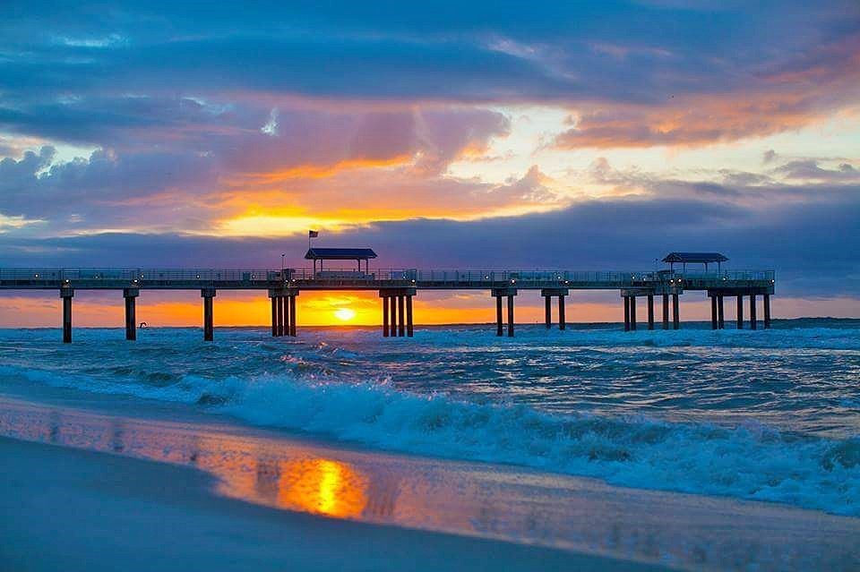 gulf shores alabama pier and ocean at sunset