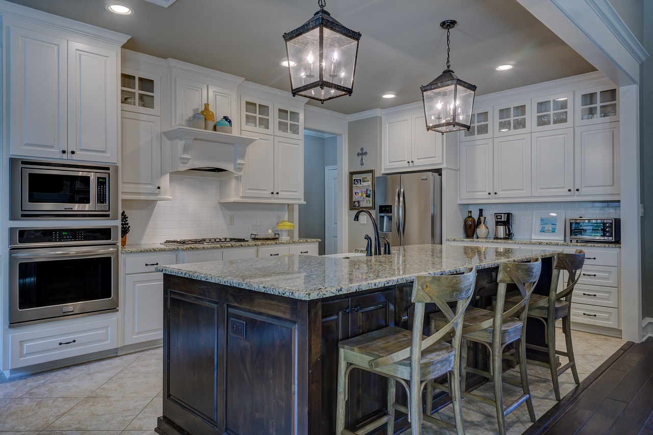 Stylish high-end kitchen with granite countertops.
